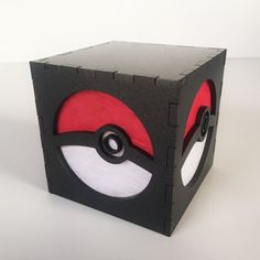 This Pokemon inspired light box features a hand-colored pokeball on each side. When the lights are out and you place a flameless tea light candle (included) underneath, it glows brightly! The box is made of laser-cut MDF, which is then painted to the color you see here. Size: 3 inch cube Color: Metallic Black    My light boxes can all be placed over a FLAMELESS battery-powered tea light or any kind of LED. (No actual fire, people!) The light box will come packaged in a gift box, and I will…