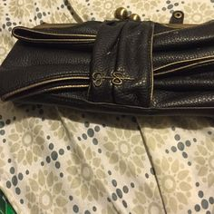My very first Jessica Simpson clutch! A black Jessica Simpson small clutch! This is my very first Jessica Simpson Clutch it has wear and a rip in the front but still in great condition If want more photos let me know! Jessica Simpson Bags Clutches & Wristlets