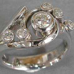 right hand ring....three small with the kids birth stones...the other two hubby and I ...diamond in the middle.