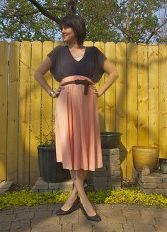 I have a skirt almost exactly like this and I'm never sure how to wear it. This may be an idea