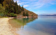 Kalami Beach – you will find it a beautiful, green bay on the northeastern coast of the island. https://greece.terrabook.com/corfu/page/kalami-beach #Greece #Corfu #terrabook #GreekIslands #TravelTips #Travel #GreeceTravel #GreekPhotos #Traveling #Travelling #Holiday #Summer