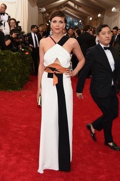 Pin for Later: Relive All the Glamour From Last Year's Met Gala Red Carpet Maggie Gyllenhaal Maggie kept it simple in a black and white halter gown.