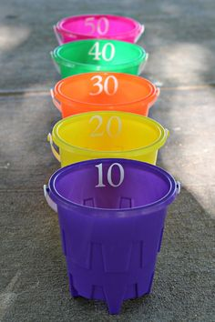 Ball or beanbag toss...sould use the sponge balls and have the buckets partly filled with water