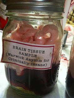 Ball jar + angel food cake + canned cherry pie filling + piped pink frosting = juicy brains-in-a-jar     sweet!