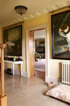 """[i]The hall and corridors are painted a shade of Cornish cream and hung with large German paintings of dogs. Chunks of raw amethyst and stuffed exotic animals and birds are displayed over two hall tables. [/i]  Like this? Then you'll love  [link url=""""http://www.houseandgarden.co.uk/interiors/hallway""""]Hallway ideas to steal[/link]"""
