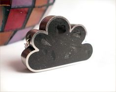 black cloud necklace $90.00 Thinking about getting this for my daughter on the days when she is grouchy and walks around like a thundercloud. hehehehe
