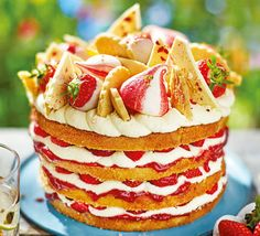 This generous cake is big enough to feed a crowd and is a combination of all our favourite summer ingredients: strawberries, Victoria sponge, meringues, fresh cream, white chocolate and buttery shortbread