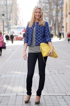 blue jacket, greyish taupe shirt, skinny jeans and heels