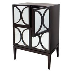 Featuring a rich and dark wenge oak veneer so deep that it retains the grain of the wood, this contemporary dark wood chest features four cupboards each having a mirrored front adorned with a trellis pattern. The doors are mirrored which reflect light and create the illusion of space. This chic chest cabinet has a distinct boutique hotel feel to it and will suit glamorous, chic and bold interiors. May also be used as a sideboard. Item dimensions: 80cm (W) x 45cm (D) x 110cm (H). £739.