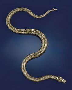 A 19th century gold and Swiss enamel serpent flexible necklace  The naturalistically articulated serpent composed of graduated tubular links with black enamel stylised scales and white enamel markings, the head with gem-set eyes, circa 1840, one ruby eye deficient, approximately 56.0 cm. long