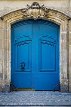 Ornate wooden doors in the Marais, Paris France. © Brian Jannsen Photography