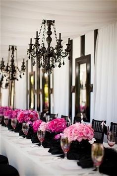 I dont think I would ever use these colors, but it looks so good! haha  Paris wedding - Chandeliers + pink flowers