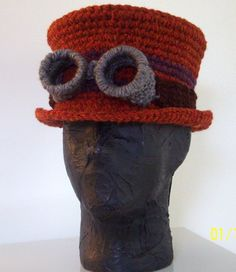 sweet crochet steampunk top hat with goggles - wish there was a pattern Crochet Beanie, Knit Or Crochet, Crochet Crafts, Crochet Projects, Knitted Hats, Beaded Crafts, Steampunk Patterns, Steampunk Top Hat, Steampunk Fashion