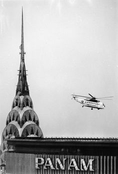 ↠A helicopter near the Pan Am building and the Chrysler building spire, 1960s. (Hulton Archive /Getty Images)