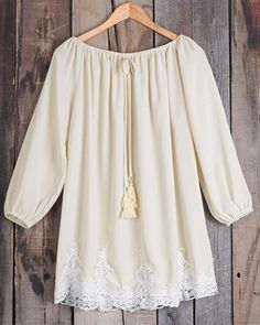 You are going to be such a babe in this dress! The off the shoulder sleeves are totally rad and that lace hem is totally far out!