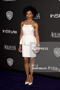 "Another look from the 'Globes! ""Grey's Anatomy"" actress Kelly McCreary looked polished and chic in the Spring 2015 white peplum dress at the InStyle and Warner Bros. Golden Globes Party!"