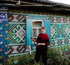 Olga Kostina is a resourceful Russian pensioner from the village of Kamarchaga in the Siberian Taiga.  Using 30,000 bottle caps, she has adorned her home in murals depicting traditional motifs and woodland creatures.  She uses a textile technique called Macrame to fabricate the mosaics and hammers in every cap by hand.
