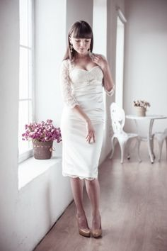 Model 13.Fitted style short wedding dress with lace jacket -the main fabric is ivory atlas with elastan, lining with elastan the same; -bust embellish by lace, molded cups, sweetheart neckline, empire line, bow-embellishments at front, vent at back, scalloped hem; -concealed zip and buttons fastening along back; -dry clean.