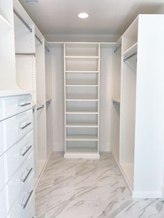 If you love a white and marble combo, don't miss this custom master closet. It's designed by a professional organizer and closet designer. Beautiful!