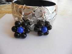 Earings with black and blue balls