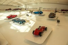"""Museo Casa Enzo Ferrari, Modena - """"In the vast stadium of fluorescent light, the cars look like glowing orbs of style"""" by @Michael Dussert Turtle"""