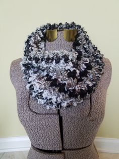This listing is for a handmade, crochet, cowl/ infinity scarf. It is made from a high-quality, low pill, acrylic yarn. It is easy to care for. The texture is lofty and very soft to the touch. The colors variegate gently in earthtones and will match almost anything youd like to pair it with. This is great to add to your own accessory wardrobe or as a gift for her.  Thank you
