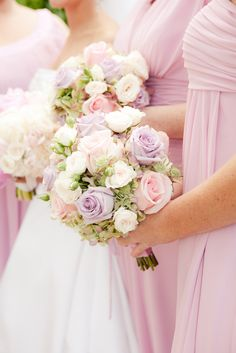 Love this bouquet. Maid of honor dress purple and bridesmaid dresses pink. Perfect bouquet those colors