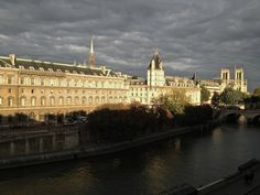 along the seine with notre dame in the   background, paris, october 2012