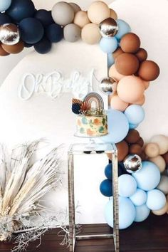 Take a look at the stunning balloon decorations and magical cake at this boho rainbow baby shower! See more party ideas and share yours at CatchMyParty.com #catchmyparty #partyideas #4favoritepartiesoftheweek #bohobabyshower #rainbowbabyshower #balloondecorations #boybabyshower #babyshowercake