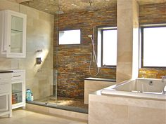 Walk in shower sunken tub love the bits of mosaic tile for Earthy bathroom ideas