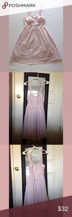 Converse One Star Dress Size S Never worn, looks brand new and is in excellent condition! Size small. 100% cotton w/ inner 100% cotton lining and hidden side zip closure. Powder pink with white and gray pinstripes. From a smoke-free, no pets household. Converse One Star Dresses Midi
