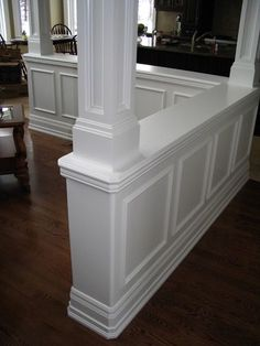 This partial wall/corner could be the solution to keeping the dining room open but defined.