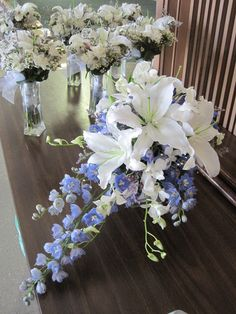 For Erin's wedding I did a dramatic bridal bouquet of white Oriental lilies, accented by a cascade of hybrid blue delphinium and white dendrobium orchids.