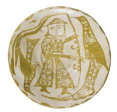 An Abbasid lustre bowl featuring a standard bearer between two birds, Iraq, 10th century