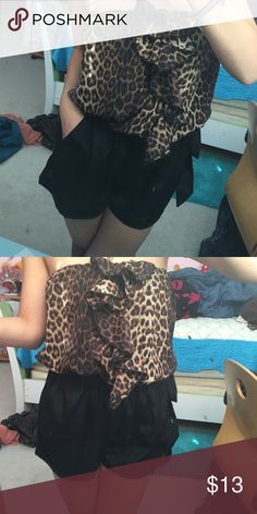 Strapless Black/ Cheetah print romper Strapless black and cheetah printed romper with pockets spacious enough to hold a phone & a ribbon to tie around the waist. Still in new condition and only worn once try to it on Papaya Dresses Strapless