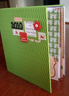 8 1/2 x 11 December Daily album  Adorable! I love how easy and clean the pages look on the inside. Must do.