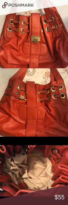 Jimmy Choo purse Excellent used condition. Not authentic but great purse still. All zippers and buckles work. Bags