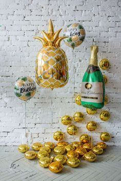 Gold-pineapple-foil-balloon-and-gold-tablet-tropical-birthday-party-ideas-photozon