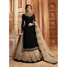 48117a0822 Bollywood diva drashti dhami style black designer lehenga style suit online  which is crafted from satin georgette fabric with exclusive embroidery, ...