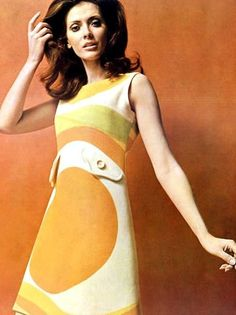what makes this dress a 60s fashion.. colour of the dress, shape of the dress, make up, hair style..