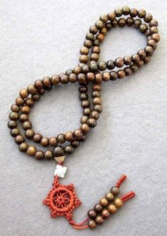 Prayer beads or japa malas are used in many forms of Mahayana Buddhism, often with a lesser number of beads than the Hindu japa malas 108 (number)--usually a divisor of 108. In Pure Land Buddhism, for instance, 27-bead rosaries are common. Some practitioners use malas of 21 or 28 beads for doing prostrations.