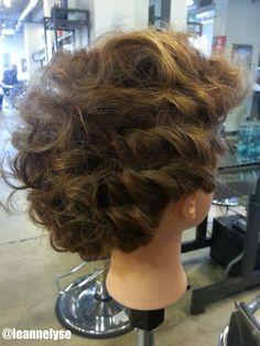 Multiple rope braids with curls pinned into a mohawk / faux-hawk shape // Created by Leann Henderson, Future Professional #803 at Paul Mitchell The School St. Louis // Call (314) 361-8200 to make an appointment! // www.facebook.com/leannhendersonstylist // Instagram: @Leann Henderson