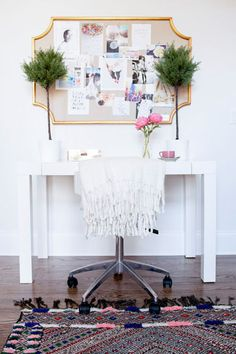 A vintage rug, West Elm desk and PB Teen Pinboard.  A lovely workspace with some personalization.