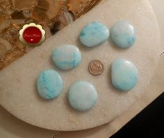 Medium Blue Aragonite Worry Stone, Blue Aragonite Palm Stone, Stone for Empaths, Empathy, Healer Stone, Calming, Grounding, Emotions & Stress  This is for one polished Blue Aragonite worry stone/palm stone that is just the right size to carry in your pocket. Keep one on you to help with
