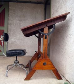 Antique Industrial 1900's Turn of the Century Drafting Table with Original Cast Iron Hardware. $400.00, via Etsy.