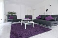 The main use of white and black with the accent of purple makes this room an example of an accent color scheme.