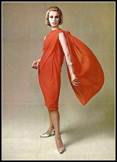 Double panel gives graceful movement to this lovely red chiffon sheath style dress by Michel Goma, shoes by Charles Jourdan, jewelry by van Cleef & Arpels, coiffure by Fernand Aubrey, photo by Pottier, 1961