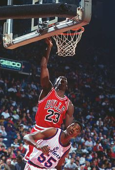 Michael Jordan of the Chicago Bulls shoots over David Wingate of the Washington Bullets during an NBA basketball game circa 1991 at the Capital...