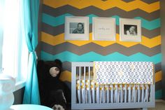 This chevron accent wall packs a punch in this colorful nursery! #nursery #chevron