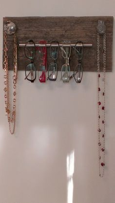 I made this eyeglass & Necklace rack with upcycled old deck wood & knobs from Anthropologie & Home Depot. Simple and Useful!